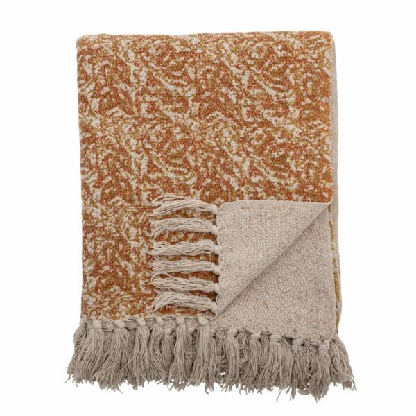 Questo plaid è realizzato in cotone riciclato. Un copriletto caldo e confortevole che contribuisce anche con colori caldi al tuo arredamento con il suo motivo rosso / marrone.